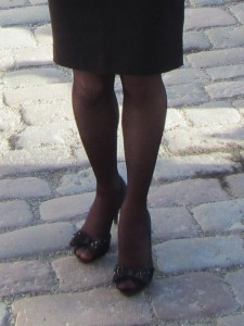 pantyhose and heels on cobble stone