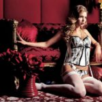 Doutzen Kroes in white stockings and corset lingerie