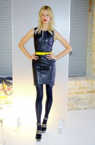 Blond model in black opaque pantyhose