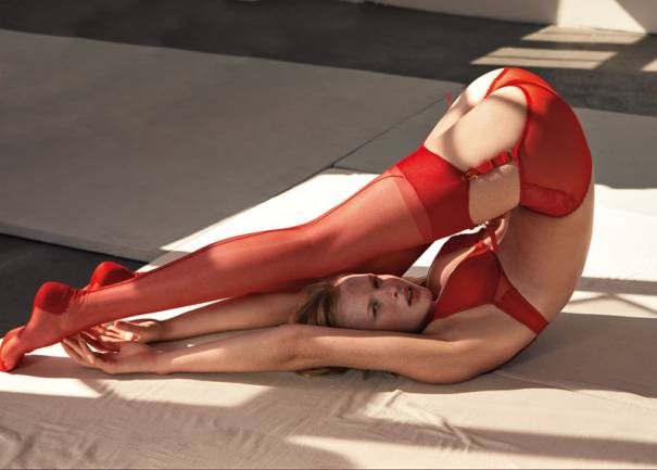 Red stockings with reinforced toes and heels, garter belt, suspender belt, and panties.