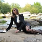 pantyhose model from waminstyle 2 - a lady in black patterned tights in a business suit with a laptop computer