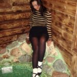 pantyhose model from waminstyle 3 - Tanya in black tights and white socks is posing in a sauna