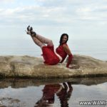 pantyhose model from waminstyle 5 - Tanya is posing in white patterned tights on top of a rock