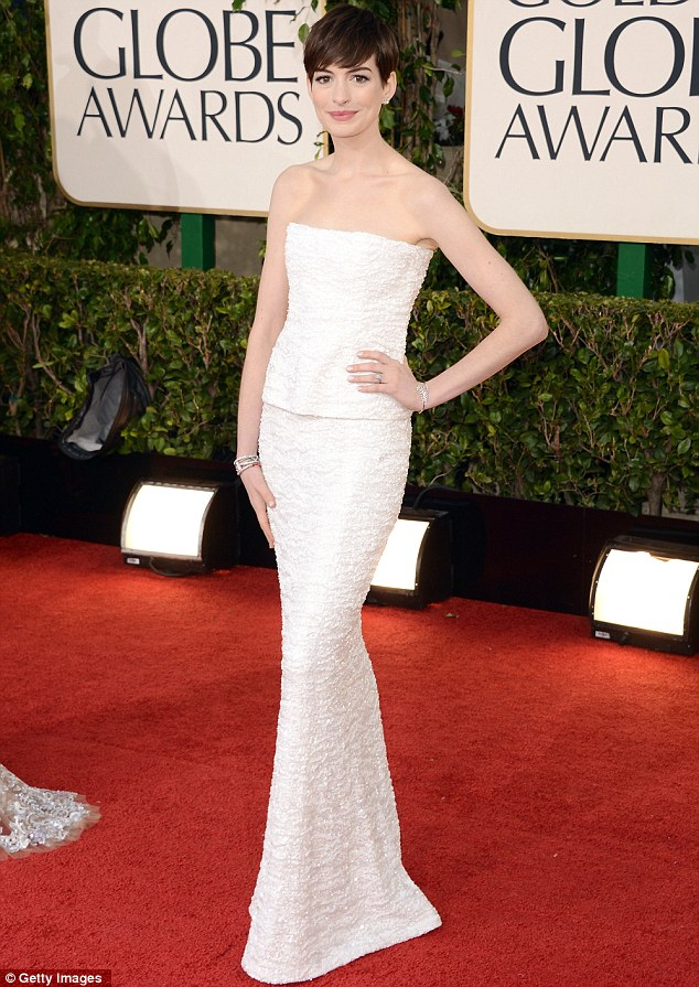 Anne Hathaway in her dress Golden Globes Award for Les Miserables