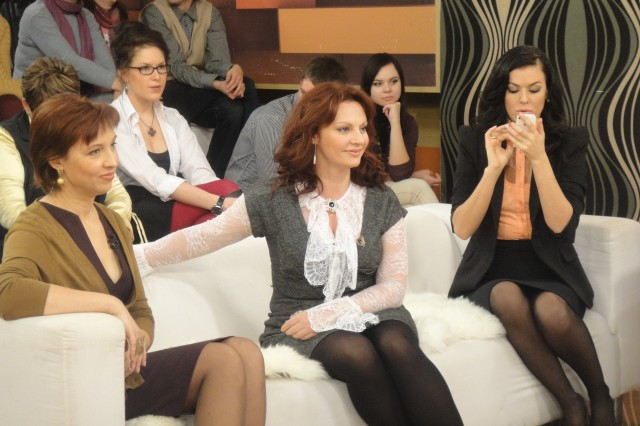 Natalya Tolstaya, in the middle, wearing pantyhose and 2 women in hosiery on the sides from her.