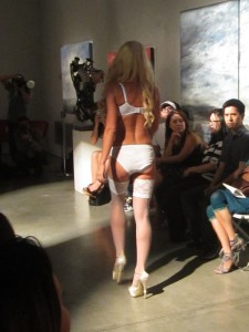 model in white stockings at dolce amore fashion show