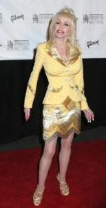 Dolly Parton in a yellow suit and pantyhose