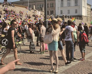white pantyhose pride parade 1, a blond girl wearing white tights in public