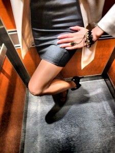 wearing a dress and jewelry with pantyhose in the elevator