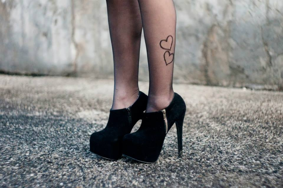 model in mandisa by Fiore heart tights 2 boots