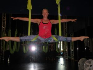 Shine Fitness in Las Vegas - Kelly in anti-gravity yoga class