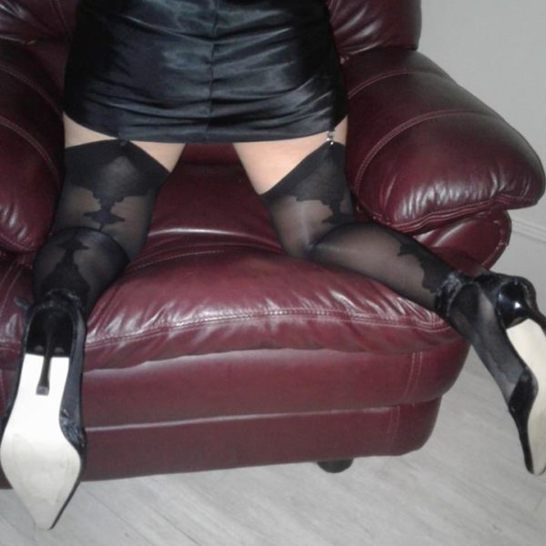 Vanity stockings by Fiore in black on a model 2