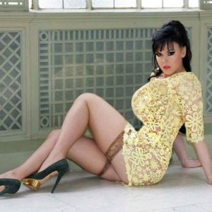Anna Azelri in a yellow lace dress and stay up stockings