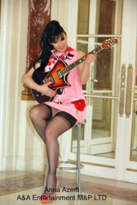 Anna Azerli posing with a guitar - Rock On Rock On stockings