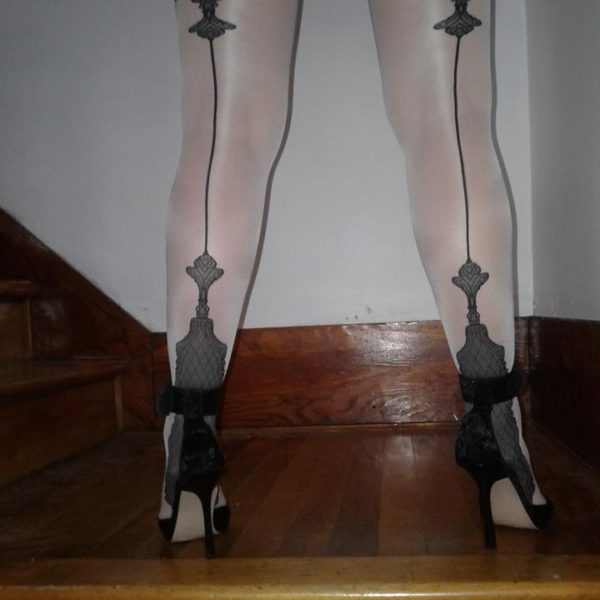 model wears Vanity stockings by Fiore with cuban heel and backseam 1