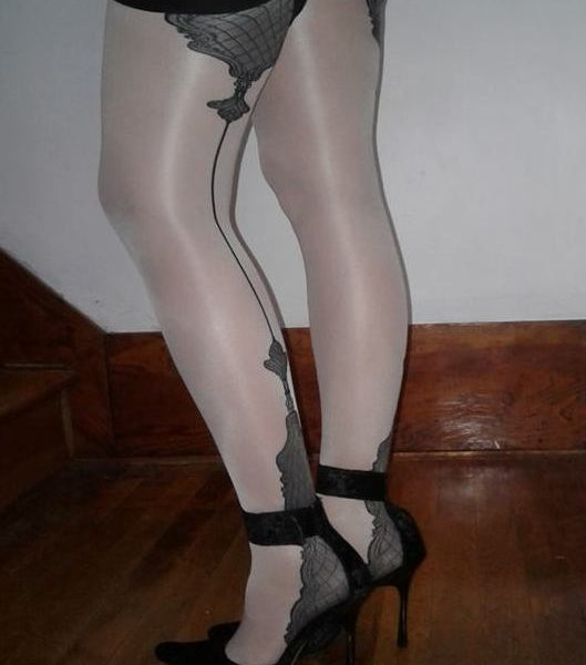 model wears Vanity stockings by Fiore with cuban heel and backseam 2