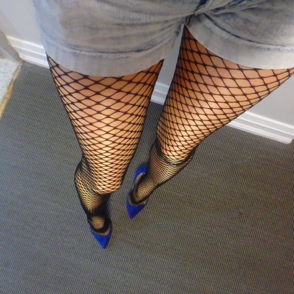 Salire fishnet tights by Fiore on my legs