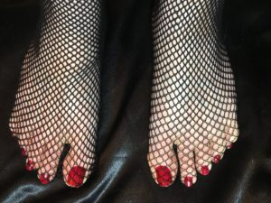 Scarlett Vixxen toes in fishnets with red nailpolish